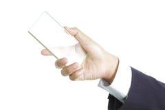 Mano que sostiene el vidrio en blanco Imagen de archivo libre de regalías