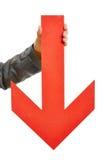 Mano que sostiene la flecha roja grande Imagen de archivo