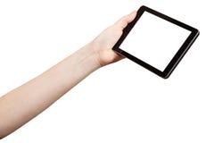 Mano que sostiene la tableta-PC con la pantalla del recorte Imagenes de archivo