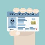 Mano que sostiene la tarjeta de la identificación stock de ilustración