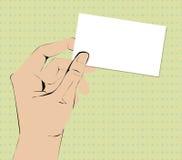 Mano que sostiene la tarjeta de visita Imagenes de archivo