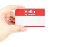 Mano que sostiene la tarjeta de visita con foto de archivo libre de regalías