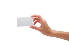 Mano que sostiene la tarjeta de visita en blanco Fotos de archivo