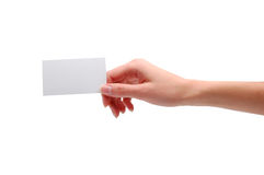 Mano que sostiene la tarjeta de visita en blanco Imágenes de archivo libres de regalías