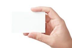 Mano que sostiene la tarjeta de visita en blanco Foto de archivo