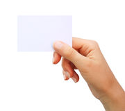 Mano que sostiene la tarjeta de visita en blanco aislada Imagen de archivo libre de regalías