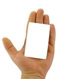 Mano que sostiene la tarjeta en blanco fotos de archivo