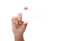 Mano que sostiene la tarjeta en blanco Imagen de archivo libre de regalías