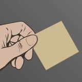 Mano que sostiene la tarjeta en blanco ilustración del vector