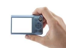 Mano que sostiene las cámaras digitales compactas imagen de archivo libre de regalías