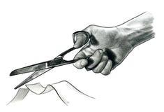 Mano que sostiene las tijeras y que corta la cinta Foto de archivo libre de regalías
