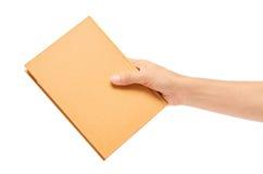 Mano que sostiene los cuadernos aislados en el fondo blanco Imágenes de archivo libres de regalías