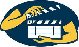 Mano que sostiene retro oval de la tablilla de la película Imagen de archivo