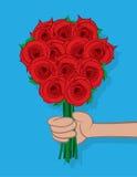 Mano que sostiene rosas Imagenes de archivo