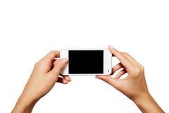 Mano que sostiene smartphone con la pantalla en blanco aislado fotografía de archivo libre de regalías