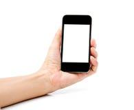 Mano que sostiene Smartphone en el fondo blanco Imagen de archivo libre de regalías