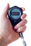 Mano que sostiene un cronómetro Imagen de archivo libre de regalías