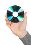 Mano que sostiene un disco del ordenador Imagen de archivo libre de regalías