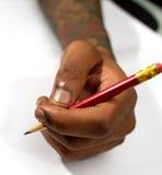 Mano que sostiene un lápiz Imagen de archivo libre de regalías