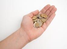 Mano que sostiene un poco de dinero Foto de archivo