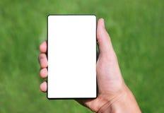 Mano que sostiene un teléfono elegante imagen de archivo libre de regalías