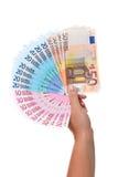 Mano que sostiene un ventilador de billetes de banco euro. Fotos de archivo libres de regalías