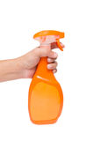 Mano que sostiene una botella del aerosol Imagenes de archivo