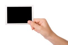 Mano que sostiene una fotografía imagen de archivo libre de regalías