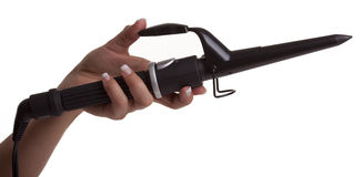 Mano que sostiene una herramienta del pelo que se encrespa Imagenes de archivo