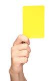 Mano que sostiene una tarjeta amarilla Imágenes de archivo libres de regalías