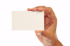 Mano que sostiene una tarjeta de visita vacía Fotos de archivo libres de regalías