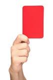 Mano que sostiene una tarjeta roja Imágenes de archivo libres de regalías