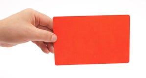 Mano que sostiene una tarjeta roja Fotografía de archivo libre de regalías