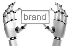 Mano robótica con el lugar de la marca de fábrica Foto de archivo libre de regalías