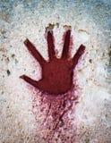 Mano rossa sulla pietra - elemento gotico grafico immagini stock libere da diritti