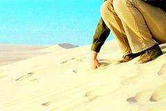 Mano in sabbia Fotografie Stock Libere da Diritti