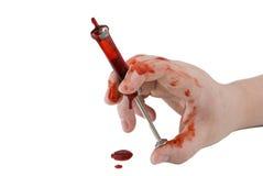 Mano sangrienta con la aguja Imágenes de archivo libres de regalías