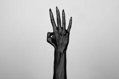 Mano sottile nera della morte Illustrazione di Stock