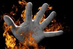 Mano su fuoco Fotografia Stock