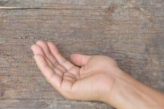 Mano su vecchio fondo di legno Fotografia Stock