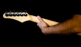 Mano sul collo della chitarra Immagine Stock