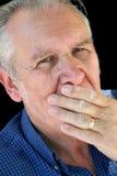Mano sull'anziano della bocca Fotografia Stock Libera da Diritti