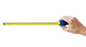 Mano umana con il tape-measure isolato Fotografia Stock Libera da Diritti
