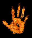 Mano umana in fiamma arancione sul nero Fotografia Stock