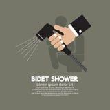 Mano usando una ducha del bidé Fotografía de archivo