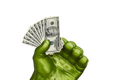 Mano verde e piccoli soldi Immagine Stock