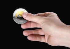 Mano y Bitcoin Fotos de archivo libres de regalías
