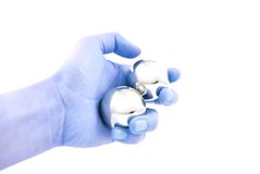Mano y bola Foto de archivo libre de regalías