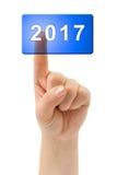 Mano y botón 2017 Imagen de archivo
