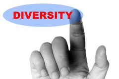 Mano y botón con la palabra de la diversidad foto de archivo libre de regalías